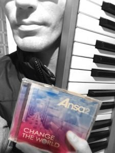 Paul holding keyboard and album CD
